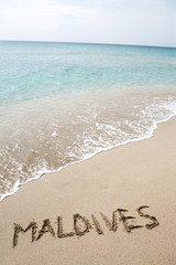 Maldives written on the sand