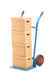 A hand truck with many boxes on it