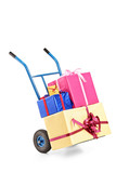 A hand truck with many gifts on it