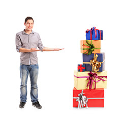 Smiling gesturing and pile of gifts