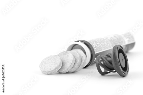 Multivitamin tube on white background