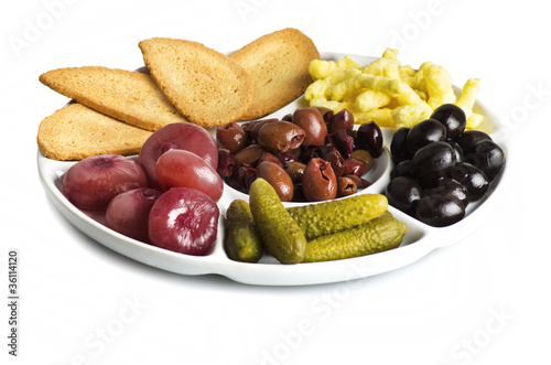 a plate of appetizer on white
