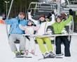 Happy skiers on ski lift