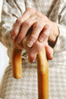 Old Lady's hands with walking stick