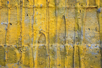 Part of a concrete wall with yellow streaks