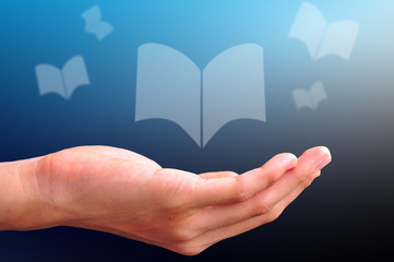 hand with floating book