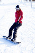Female snowboarder on the snowhill