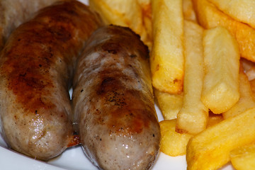 Close up of Sausage and chips.