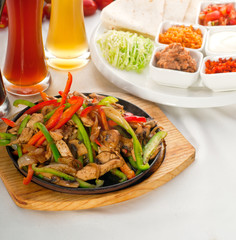 original fajita sizzling hot  on iron plate