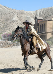 Cowboy escapes on s horse at Mini Hollywood, Almeria, Spain