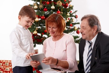 Small boy with grandparents at christmas