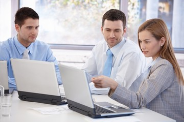 Attractive businesspeople working together smiling