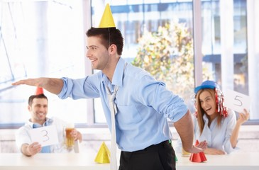 Young man having fun at office party