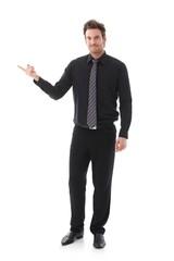 Businessman balancing sg on forefinger