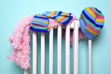 Girls hat scarf and gloves drying on a radiator