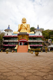 golden buddha in dambulla, sri lanka