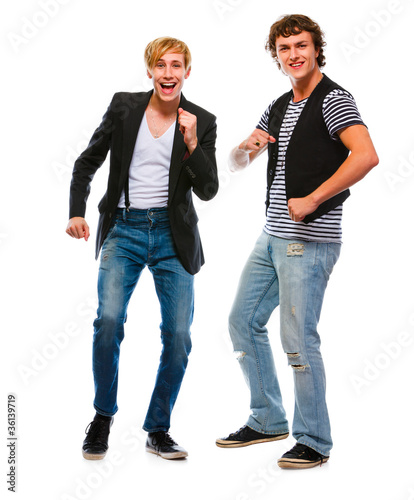 Two modern young men dancing on white background