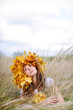 young woman in the autumn field smiling and watching up