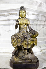 buddha image in buddhist temple, sri lanka, after the rain