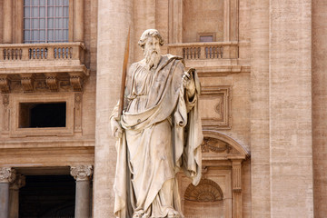 Statue of Saint Paul with his sword, looking down at us