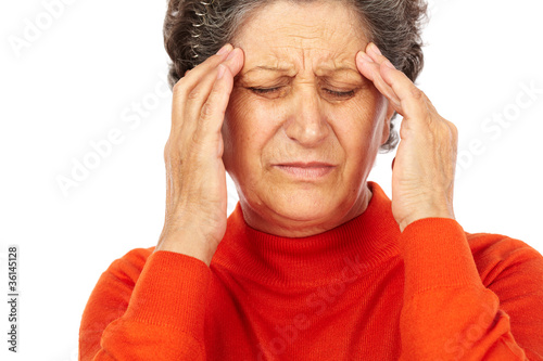 Leinwanddruck Bild Senior woman with headache