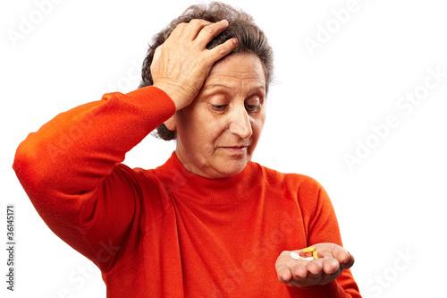Leinwanddruck Bild Senior woman with too many pills