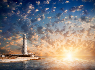 lighthouse and beautiful sunset