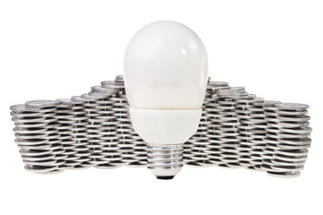 Power saving lightbulb with stacked silver coins behind.