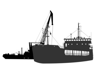 Silhouettes of the barge and the floating crane