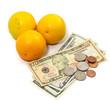 orange fruit with money