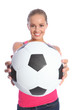 Beautiful smiling teenage girl with soccer ball