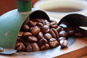 Macro shot of coffee beans in antique coffee grinder