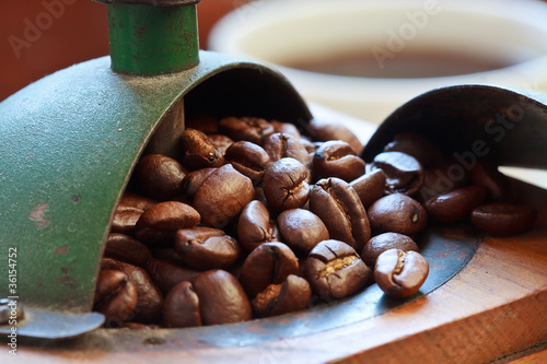 Macro shot of coffee beans in antique coffee grinder