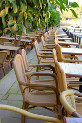 Street cafe with wicker chairs