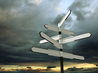 Image of blank signpost over dramatic sky