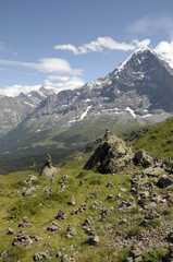 Cairns on Mannlichen path with Eiger