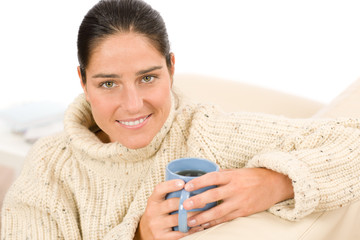 Winter portrait happy woman hold coffee cup