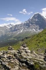 Cairns on Mannlichen path with Eiger