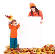 Family with child on autumn leaves holding banner.