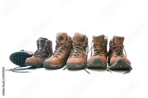 Three pairs of hiking boots. Concept for family hiking