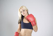 Elegant pose woman boxer with red gloves