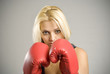 Portrait of woman boxer with red gloves