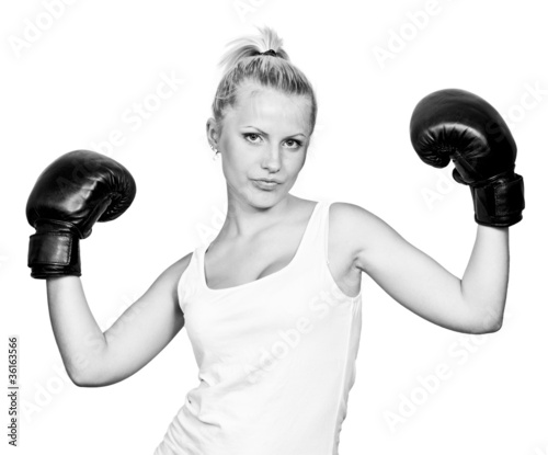 Beautiful blonde girl in boxing gloves