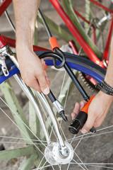Close-up of a man's hands locking his bicycle, Paris, Ile-de-France, France