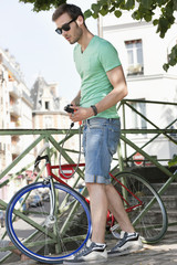 Man holding a lock for locking his bicycle, Paris, Ile-de-France, France