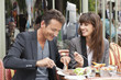Couple enjoying lunch at a restaurant, Paris, Ile-de-France, France