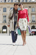 Couple walking on a street, Paris, Ile-de-France, France