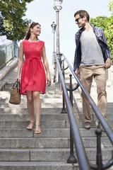 Couple moving down staircases, Montmartre, Paris, Ile-de-France, France