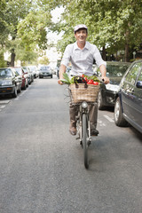 Man carrying vegetables on a bicycle, Paris, Ile-de-France, France