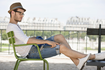 Man resting in a chair, Jardin des Tuileries, Paris, Ile-de-France, France